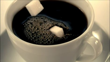 733450029-sugar-cube-dunking-procedure-coffee-cup-sweet-taste